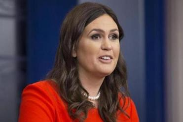 White House press secretary Sarah Huckabee Sanders would not respond specifically Friday to whether Trump believes he can pardon himself.
